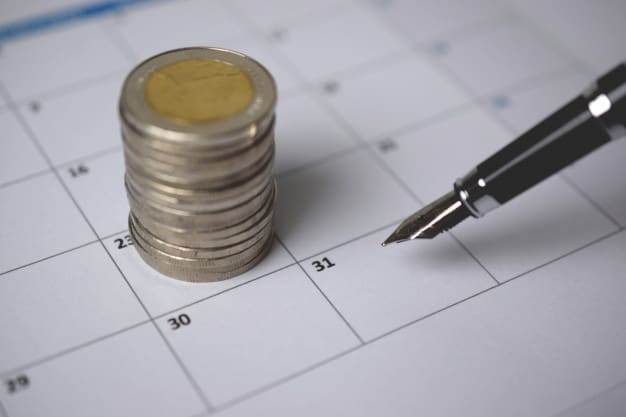 Coins, pend and calendar