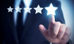 Businessman hand touching five star review