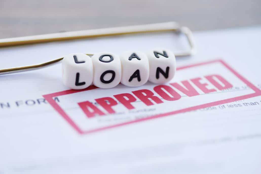 White block loan text on approved application form